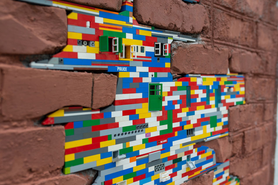 Brick wall and Lego pieces.