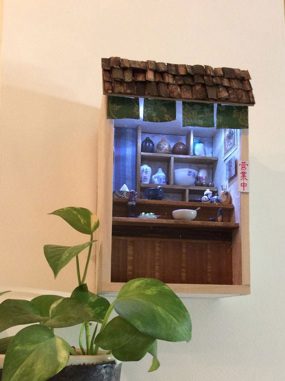 Aspecto de ventana de casa miniatura.