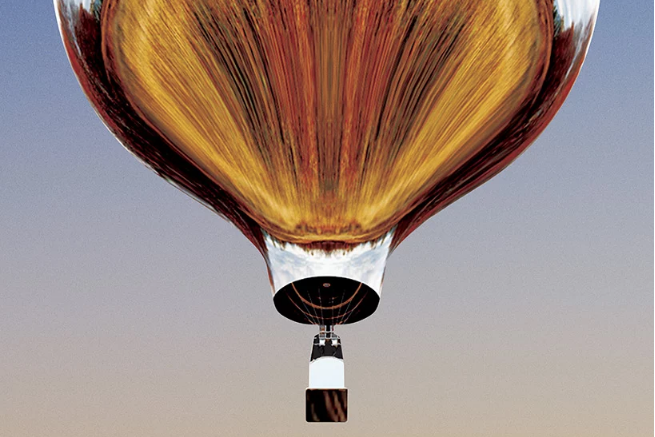 एक सनी घास के मैदान के परिदृश्य के साथ एरोस्टेटिक गुब्बारे की तस्वीर