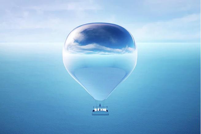दिन में समुद्री परिदृश्य के साथ एरोस्टेटिक गुब्बारे की तस्वीर