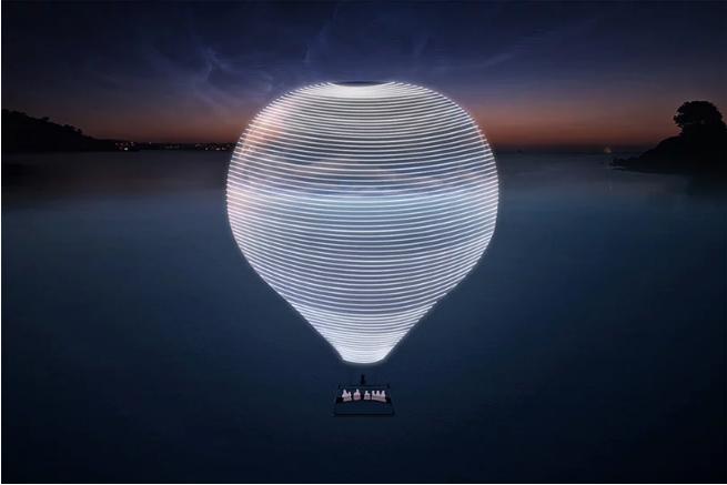 नाइट सी लैंडस्केप के साथ एरोस्टेटिक गुब्बारे की तस्वीर