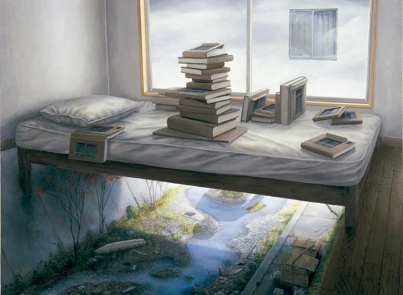 शीर्ष पर पुस्तकों के साथ बिस्तर