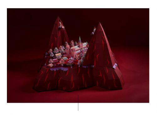 Maqueta de castillo rojo y montanas