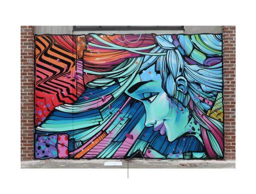 Graffiti del artista Sofles con el rostro de una mujer
